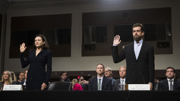 Facebook Chief Operating Officer Sheryl Sandberg and Twitter Chief Executive Officer Jack Dorsey testify during a Senate intelligence committee hearing on Sept. 5.
