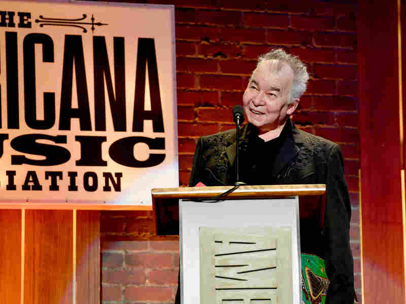 John Prine accepts an award onstage during the 2018 Americana Music Honors and Awards.