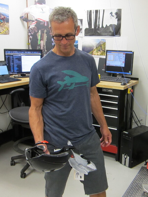 After testing a counterfeit helmet to see how well it handles a direct impact, Clint Mattacola of Specialized Bicycles holds the results — the fake helmet split in half. If a person had been wearing it, they could have suffered brain damage or death, he says.