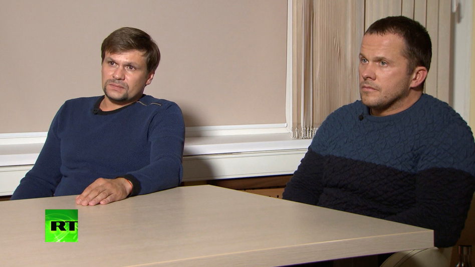 A still image taken from a video released by the RT TV shows two Russian men who say they are Ruslan Boshirov (left) and Alexander Petrov. British police accuse the pair of being intelligence officers who tried to kill former KGB spy Sergei Skripal. (RT via Reuters)
