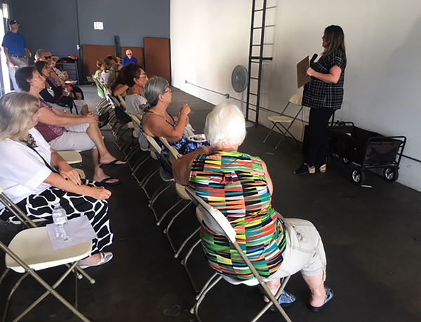 Kandice Hawes, director of Community Outreach for Bud and Bloom Cannabis store in Santa Ana, Calif., gives seniors an overview of medical marijuana.