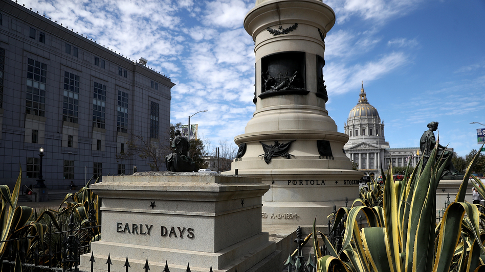 An empty pedestal remains where a statue known as <em>Early Days</em>, which depicted a Native American at the feet of a Catholic missionary and Spanish cowboy, used to stand on Fulton Street in San Francisco. The statue was removed early Friday morning.