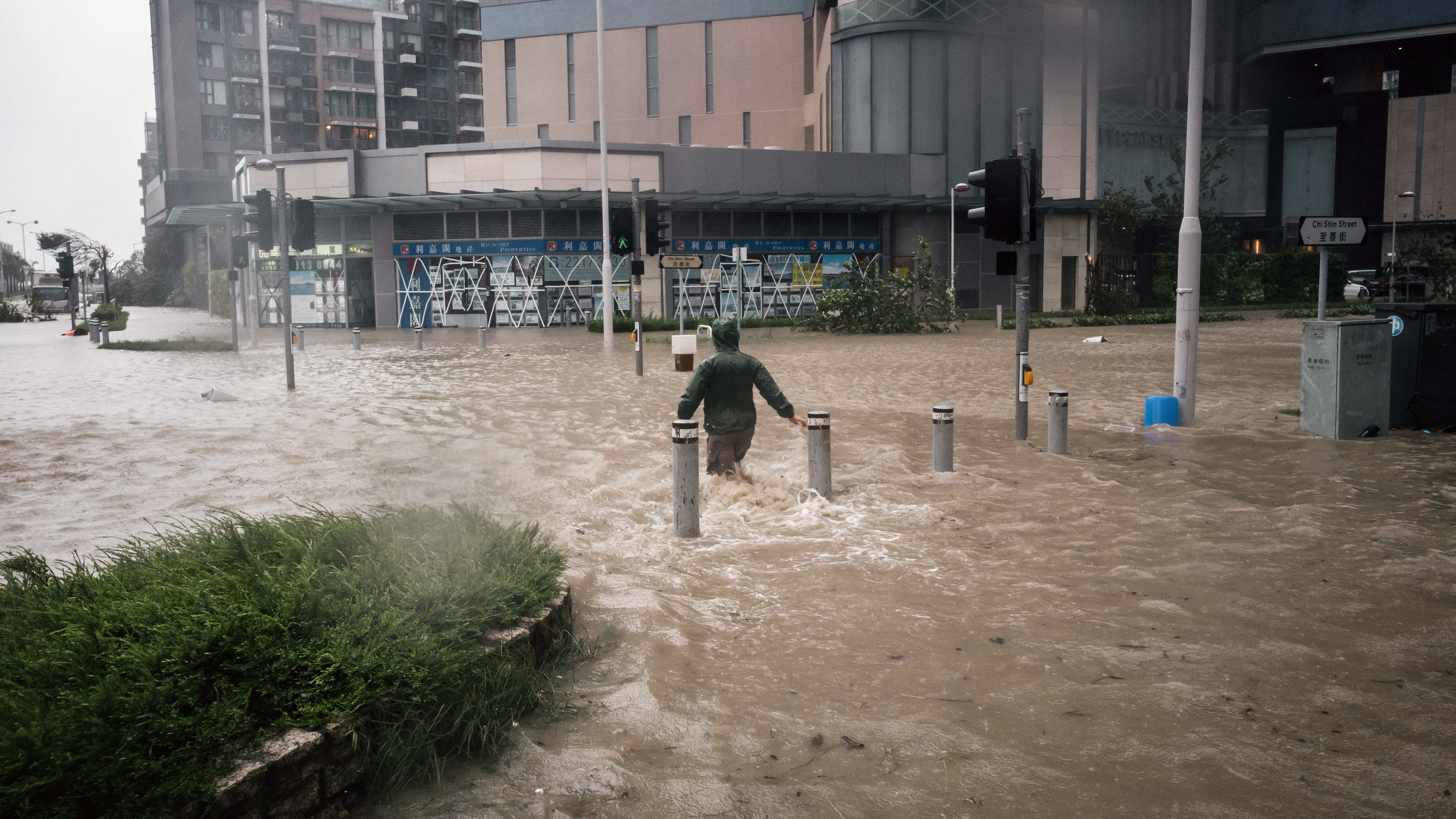 A man wades through flooded streets during a No. 10 Hurricane Signal raised for Typhoon Mangkhut in Hong Kong on Sunday.