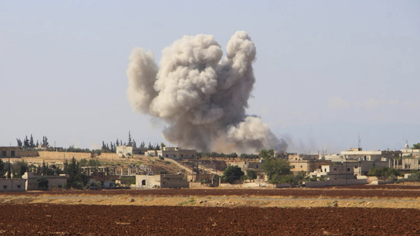 This photo released on Sept. 10 by the Syrian Civil Defense group, known as the White Helmets, shows smoke rising from an airstrike, in Hobeit village, near Idlib, Syria.