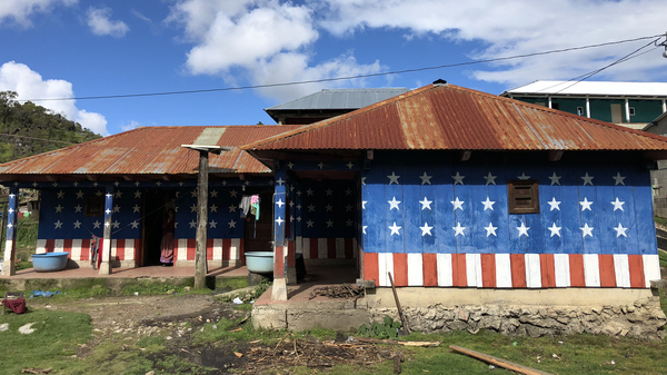 In the village of Quilin Novillo, the houses are billboards for the American dream. One is painted red, white and blue, with stars and stripes.