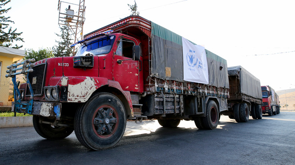 A World Food Programme convoy carries humanitarian aid to Aleppo, Syria. Getting food into conflict zones is a major hurdle — and a topic of discussion at the WFP
