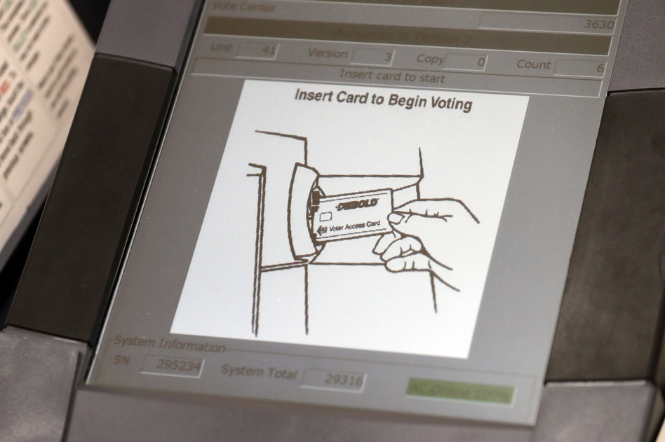 A touchscreen voting machine in Sandy Springs, Ga., during the primary election in May 2018. As the midterm congressional primaries heat up amid warnings of Russian hacking, about 1 in 5 Americans will be casting their ballots on machines that do not produce a paper record of their votes. (John Bazemore/AP)