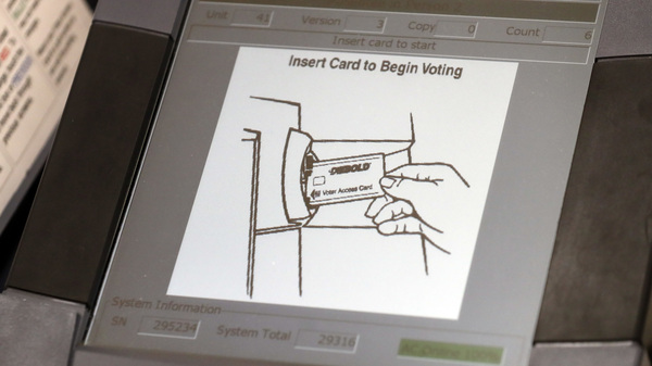 A touchscreen voting machine in Sandy Springs, Ga. during the primary election in May 2018. As the midterm congressional primaries heat up amid warnings of Russian hacking, about 1 in 5 Americans will be casting their ballots on machines that do not produce a paper record of their votes.