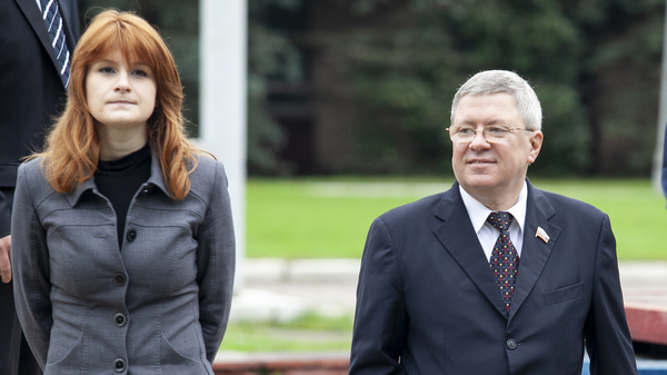 In this file photo taken on Friday, Sept. 7, 2012, Maria Butina walks with Alexander Torshin, then a member of the Russian upper house of parliament, in Moscow, Russia.