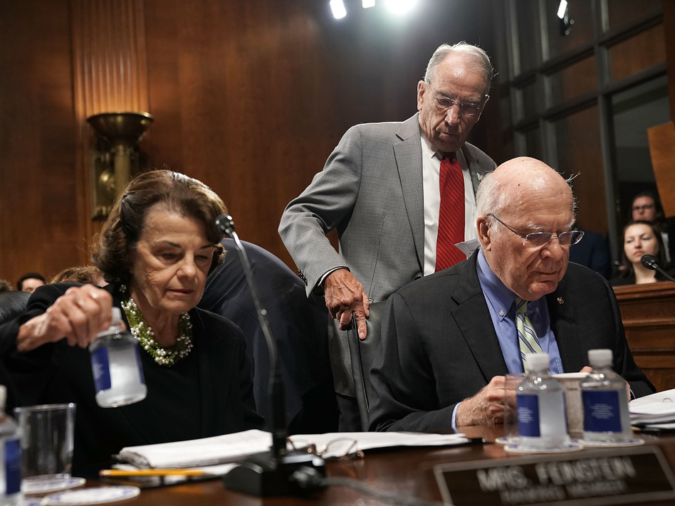 Democratic Sens. Dianne Feinstein and Patrick Leahy (seated) with Judiciary Committee Chairman Chuck Grassley. (Alex Wong/Getty Images)