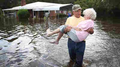 Floodwaters Rise In Carolinas, Taking Lives And Prompting Environmental Concerns