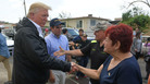 President Trump visits residents of Puerto Rico affected by Hurricane Maria last October. The president has been criticized for questioning the death toll from that storm while the U.S. mainland prepared for Hurricane Florence last week.