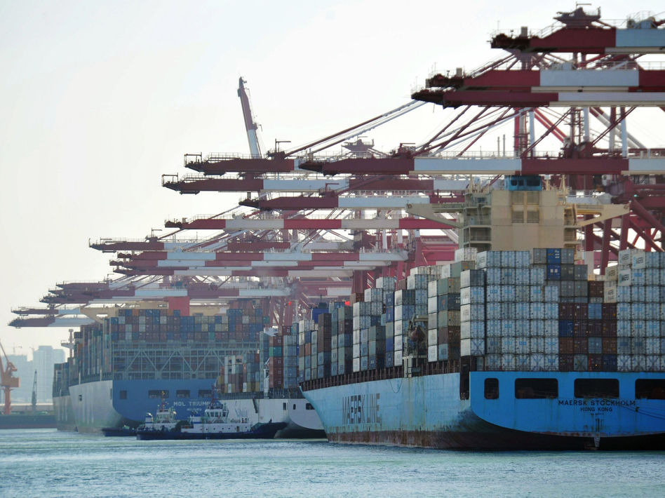 Cargo containers are loaded on ships at a port in Qingdao in China's eastern Shandong province in April. China said it will impose tariffs of 5 percent to 10 percent on $60 billion worth of U.S. products, starting on Monday. (-/AFP/Getty Images)