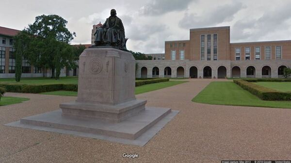 """Rice University says many undergraduate students from families with incomes up to $200,000 """"will no longer be required to take out loans."""" Here, a statue of the school"""