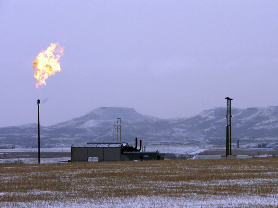 A gas flare at a natural gas processing facility near Williston, N.D. The Trump administration wants to ease regulations on methane emissions from energy production on public lands. (Matthew Brown/AP)