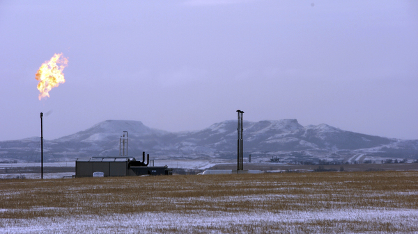 A gas flare at a natural gas processing facility near Williston, N.D. The Trump administration wants to ease regulations on methane emissions from energy production on public lands.