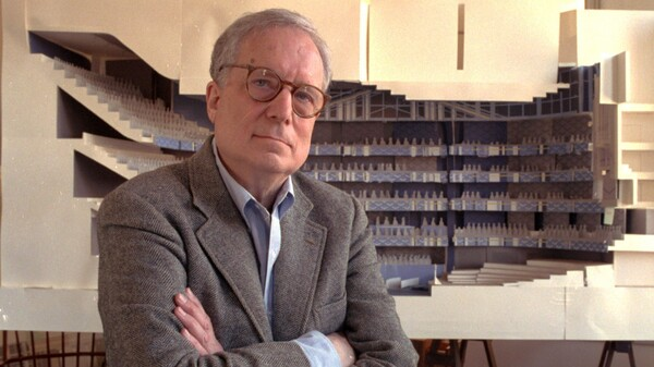 Robert Venturi poses in front of a model of a new hall for the Philadelphia Orchestra. He died on Tuesday.