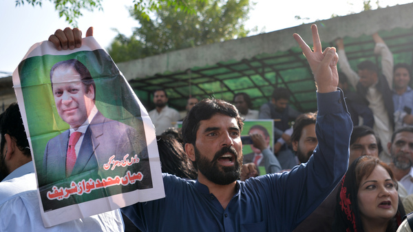 Pakistani supporters of ousted Prime Minister Nawaz Sharif carry posters and banners outside the high court building in Islamabad on Wednesday as they celebrate his release from prison. Sharif is appealing the conviction, which followed a major corruption scandal.