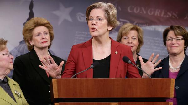 Former U.S. Sen. Barabara Mikulski (D-MD), U.S. Sen. Debbie Stabenow (D-MI), U.S. Sen. Elizabeth Warren (D-MA), U.S. Sen. Tammy Baldwin (D-WI) and U.S. Sen. Amy Klobuchar (D-MN) join other women Democratic senators for a news conference at the U.S. Capitol January 30, 2014.