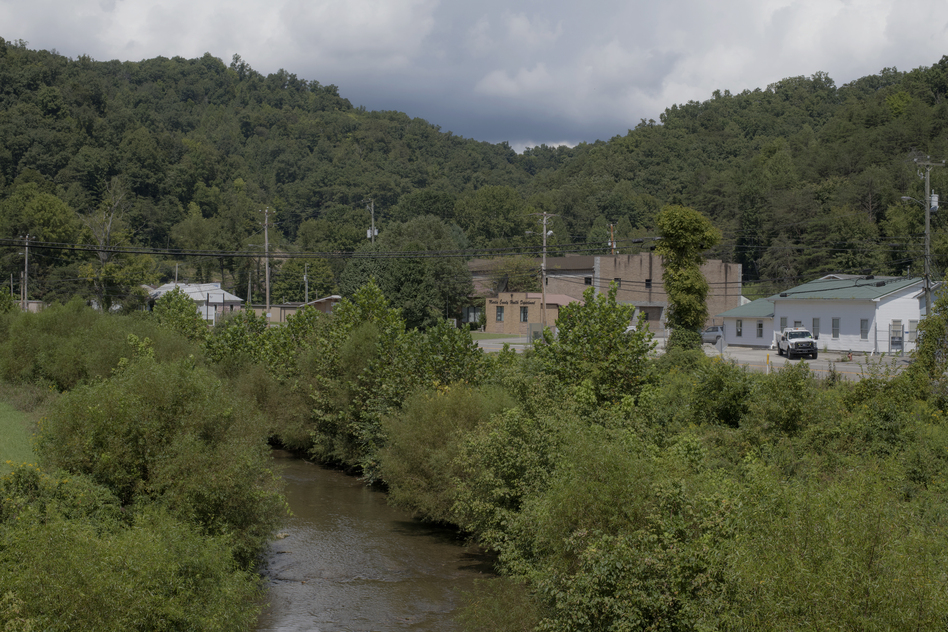 Rockcastle Creek flows past residential homes and businesses along Route 3 in the town of Inez in Martin County, Ky. People in Martin County still don't trust the tap water. The water issues in Martin County are multi-layered and it's hard to pinpoint exactly when they started. (Rich-Joseph Facun for NPR)
