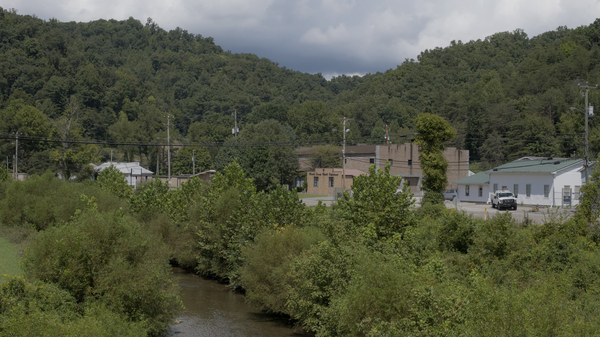 Rockcastle Creek flows past residential homes and businesses along Route 3 in the town of Inez in Martin County, Ky. People in Martin County still don