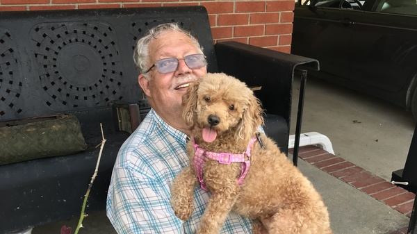 """Jerry Gray with his dog, Zoe, who he also calls """"Sweetie"""" and """"Hard Head."""" Zoe was the only pet his deceased wife, Hilda, would allow in their house. After losing his wife and now his house, Gray says Zoe means everything to him. """"If I lost her, forget it,"""" he says."""