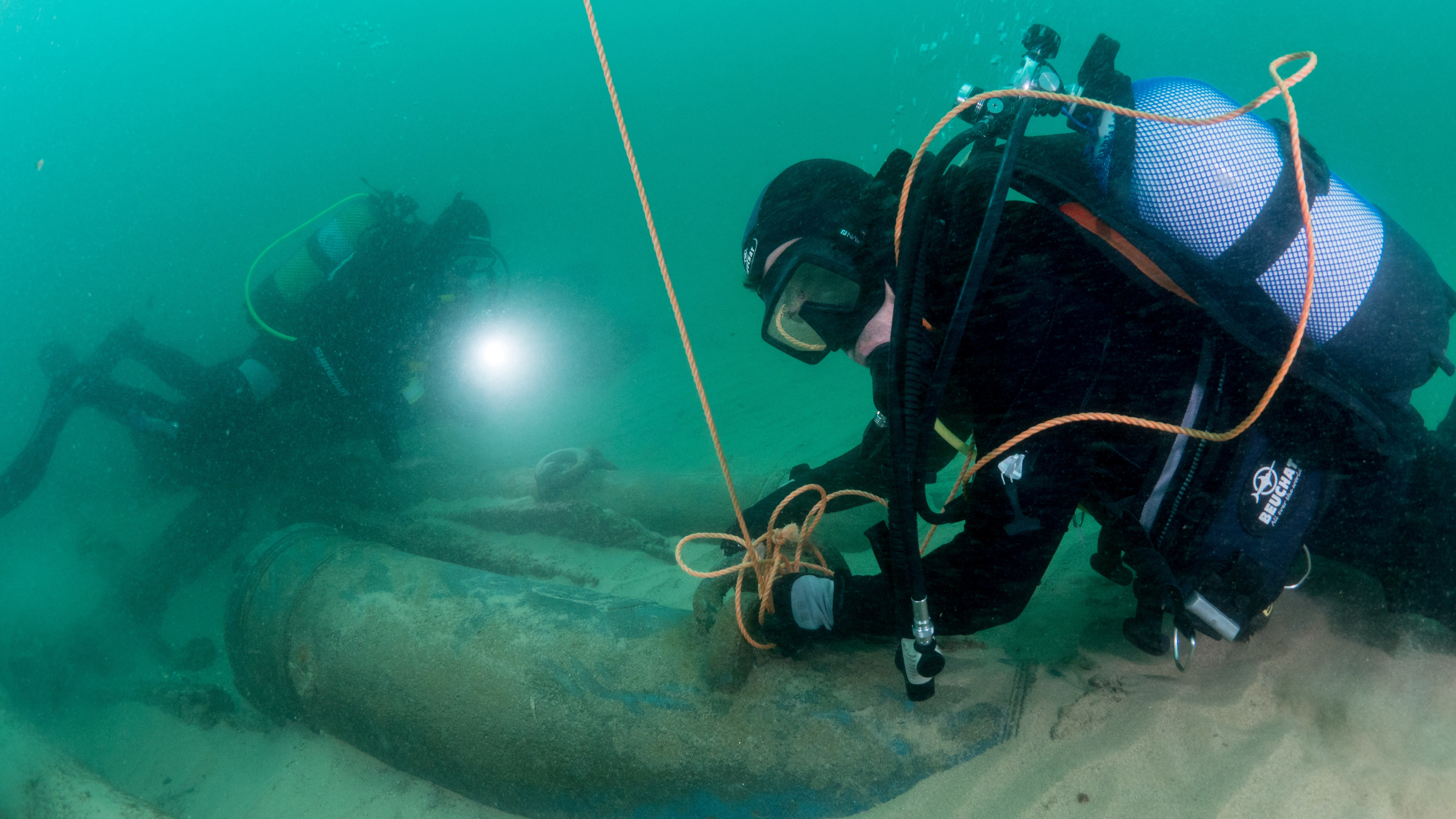 Divers are seen during the discovery of a centuries-old shipwreck, in Cascais in a photo released Monday.