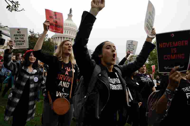 Demonstrators march in front of the Capitol.