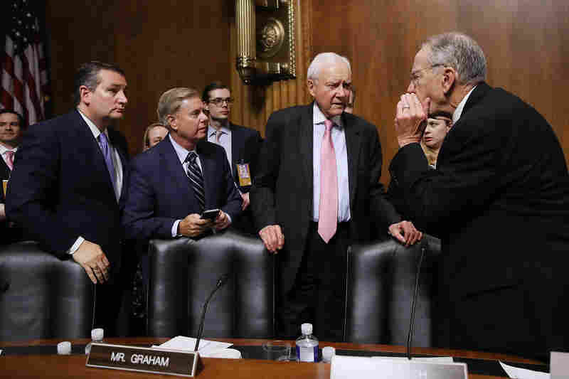Senate Judiciary Committee members Ted Cruz, R-Texas (from left), Lindsey Graham, R-S.C., Orrin Hatch, R-Utah, and Chairman Charles Grassley, R-Iowa, talk at the conclusion of the hearing for Kavanaugh.