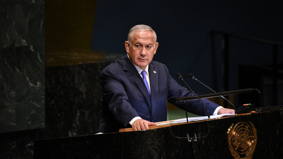 Israeli Prime Minister Benjamin Netanyahu applauds President Trump during a speech at the United Nations during the U.N. General Assembly on Thursday. (Stephanie Keith/Getty Images)