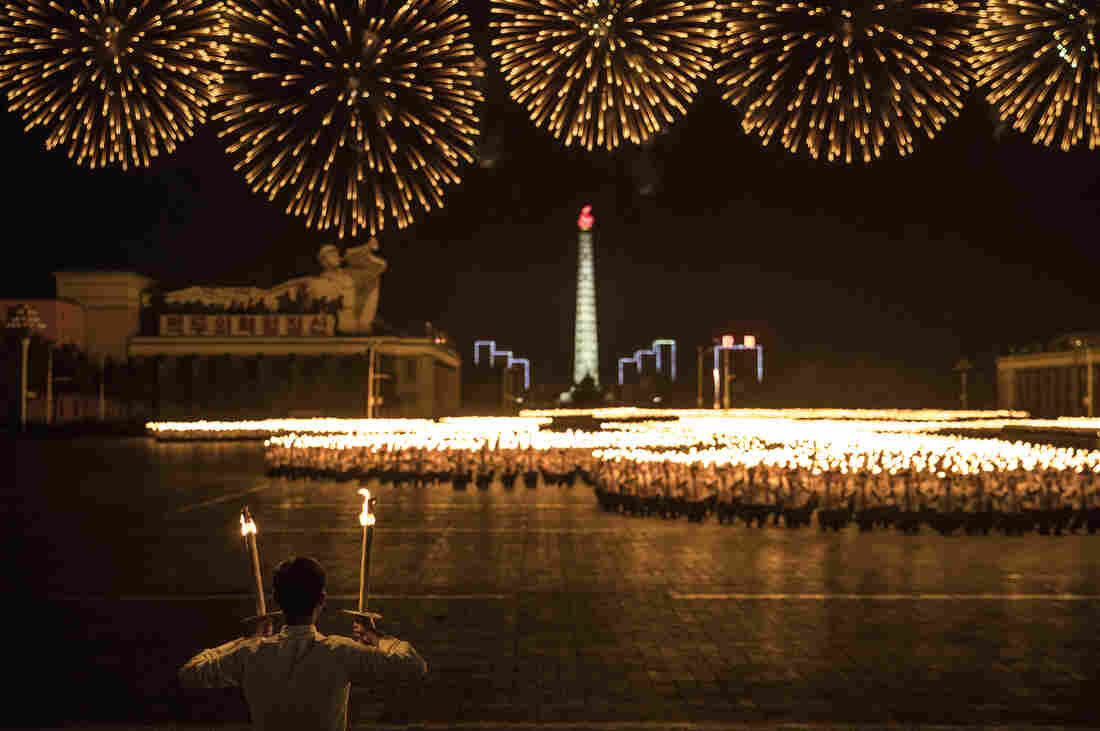 North Korean students hold a mass march carrying torches on Kim Il Sung Square in Pyongyang to mark its 70th anniversary of the nation's founding.