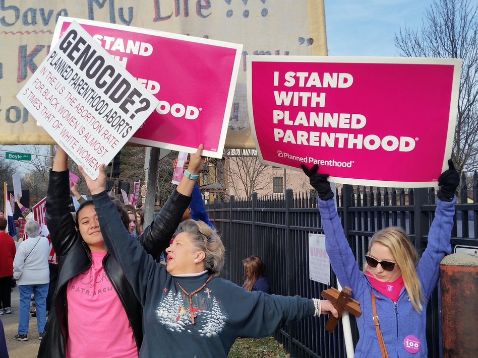 The state of Missouri has just one health clinic that provides abortions as of Wednesday, following new state requirements. In this 2017 photo, Planned Parenthood supporters and opponents protest and counterprotest in St. Louis. (Jim Salter/AP)
