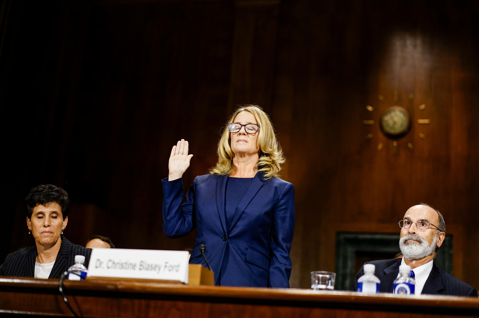 Kavanaugh accuser Christine Blasey Ford is sworn in before testifying Thursday at a confirmation hearing for the Supreme Court nominee. (Pool/Getty Images)