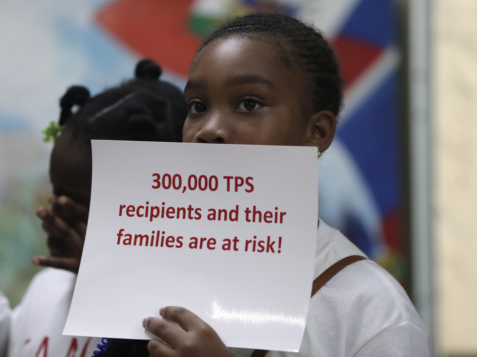 Tarauji Morris listens during a July 2018 news conference where immigration rights supporters urged the Trump administration to extend TPS. (Lynne Sladky/AP)