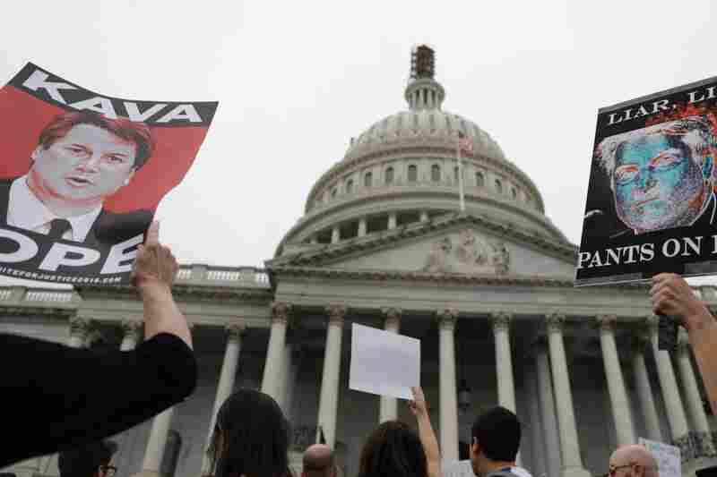 Protesters gather outside the U.S. Capitol after the Senate confirmed Supreme Court nominee Brett Kavanaugh.