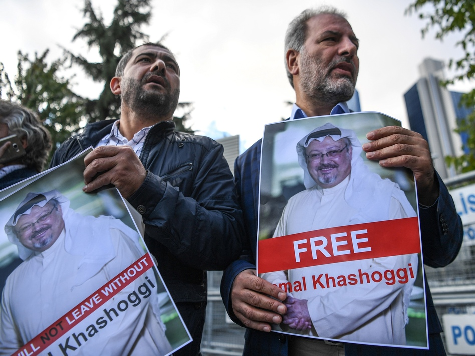 Protestors hold pictures of missing journalist Jamal Khashoggi during a demonstration in front of the Saudi Arabian consulate, on Friday in Istanbul. (Ozan Koze/AFP/Getty Images)
