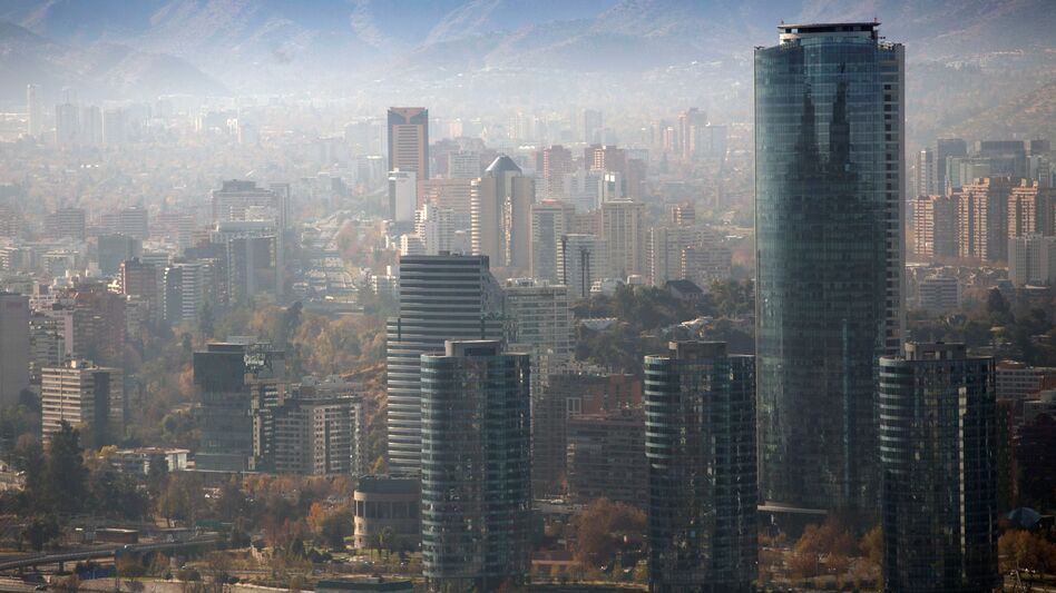 Smog blankets Santiago, Chile, in June. A U.N. report warns that even a 1.5-degree C increase in global temperatures will cause serious changes to weather, sea levels, agriculture and natural eco-systems. (Cllaudio Reyes/AFP/Getty Images)