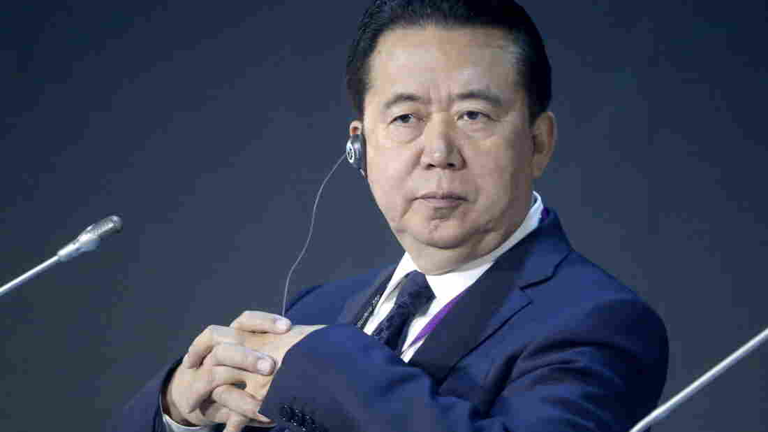 China accuses ex-Interpol chief of bribery