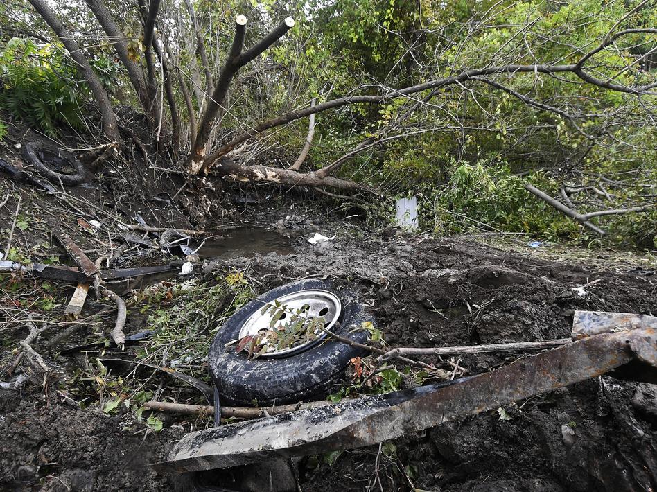 Debris litters the scene of the limousine crash last weekend in Schoharie, N.Y. On Wednesday, Nauman Hussain, identified by police as the operator of Prestige Limousine, was taken into custody.