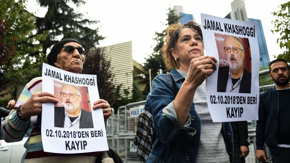 Protesters outside Saudi Arabia's consulate in Istanbul hold portraits of missing journalist Jamal Khashoggi, who disappeared after visiting the consulate last week. Turkish officials say a squad of Saudi men killed him.