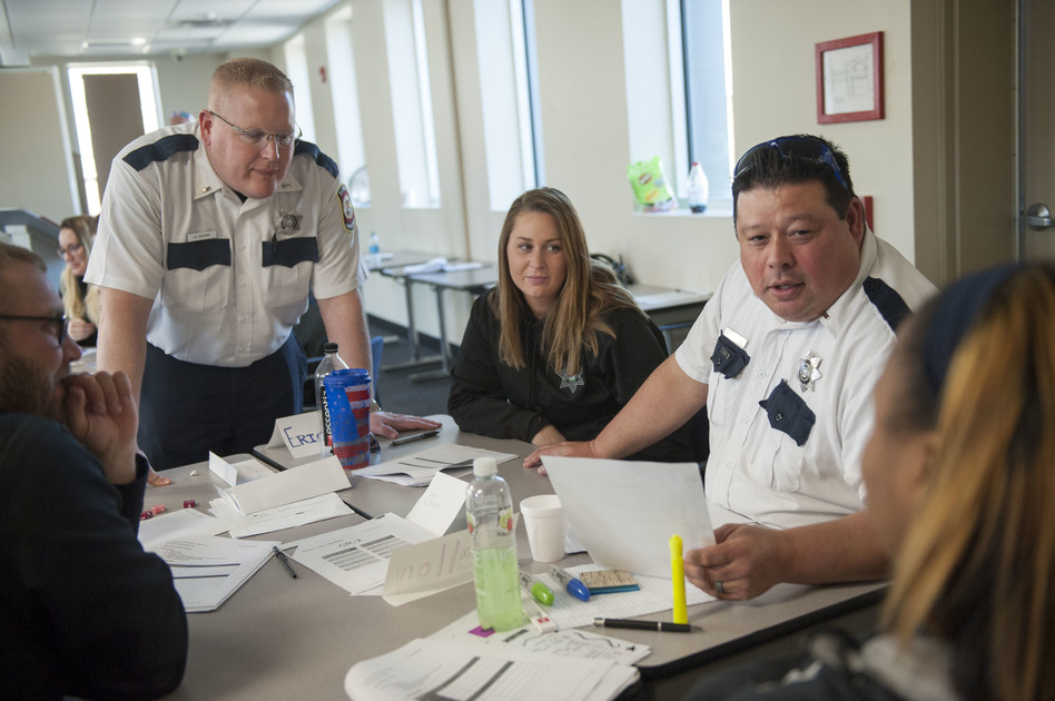 Illinois Department of Corrections officers participate in a role-playing exercise during a March training session on working with female inmates, at Logan Correctional Center in Lincoln, Ill. (Bill Healy for SJNN)