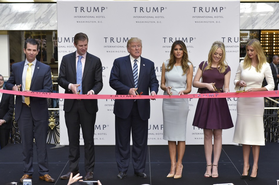President Trump has refused to divest himself of businesses and investments that could pose conflicts of interest. For example, the Trump International Hotel (seen here), located just blocks from the White House, regularly hosts events with foreign diplomats, interest groups and industry associations. (Mandel Ngan/AFP/Getty Images)