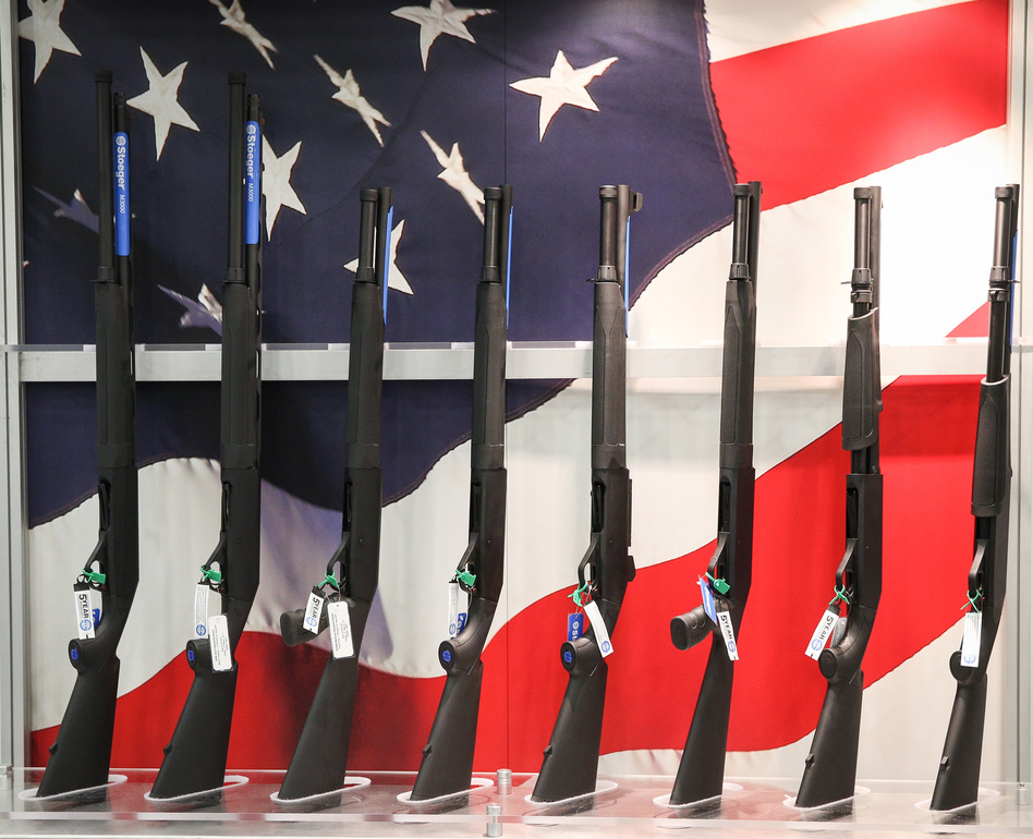 Firearms are exhibited at the annual NRA convention in Dallas this past May. RJ Young's book <em>Let It Bang</em> examines the NRA's relationship with race through his personal, unexpected interest in guns. (Loren Elliott/AFP/Getty Images)