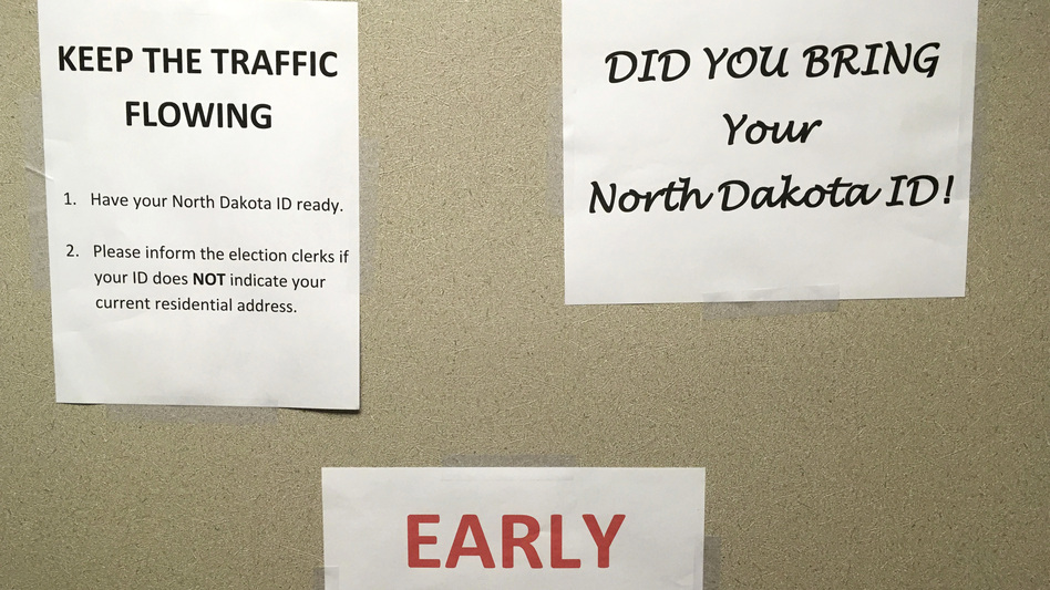 This June, instructions were posted at an early voting precinct in Bismarck, N.D. In that primary election, tribal IDs that did not show residential addresses were accepted as voter ID. But those same IDs will not be accepted in the general election.