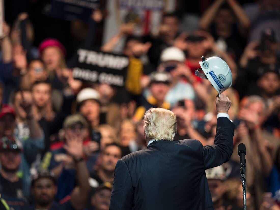 US Republican presidential candidate Donald Trump holds a miner's helmet up after speaking during a rally May 5, 2016 in Charleston, West Virginia. BRENDAN SMIALOWSKI/AFP/Getty Images