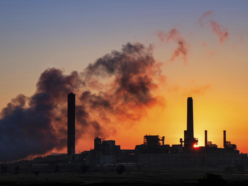 The Dave Johnson coal-fired power plant against the morning sun in Glenrock, Wyo. Democrats in some midterm swing races are targeting the Trump administration's environmental rollbacks and climate denial. (J. David Ake/AP)