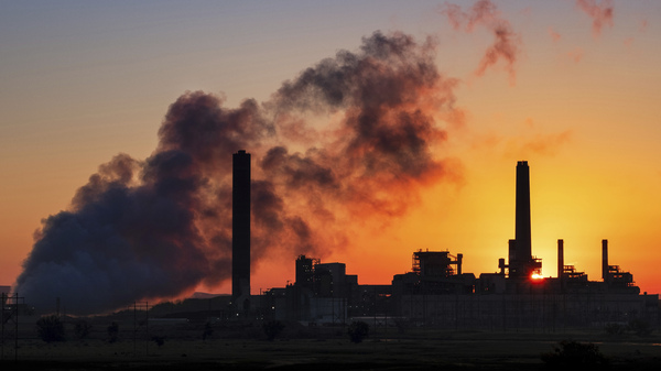 The Dave Johnson coal-fired power plant against the morning sun in Glenrock, Wyo. Democrats in some midterm swing races are targeting the Trump administration