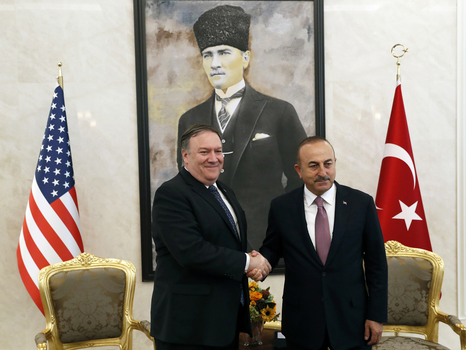 U.S. Secretary of State Mike Pompeo shakes hands with Turkish Foreign Minister Mevlut Cavusoglu before their official talks in Ankara, Turkey, on Wednesday. (Leah Millis/AP)