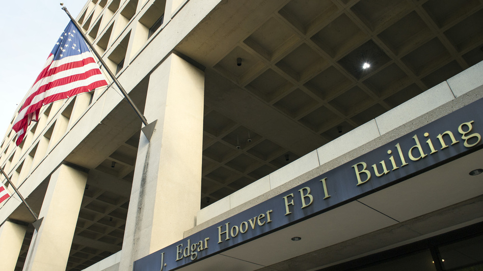 Democrats accuse President Trump of intervening in the decisions involving the fate of the FBI's headquarters in Washington to help protect his hotel up the street. (Cliff Owen/AP)