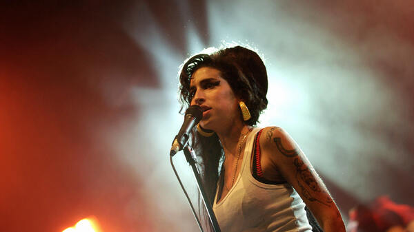 Amy Winehouse performs at the Eurockeennes Music Festival in France in 2007.
